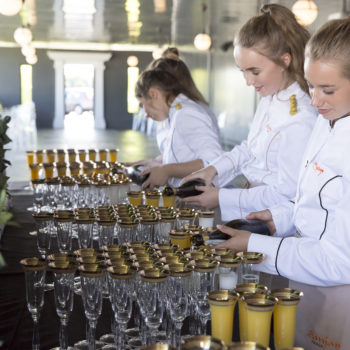 Sanjay Foods staff serving champagne