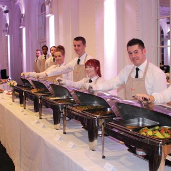 waiting staff serving buffet food