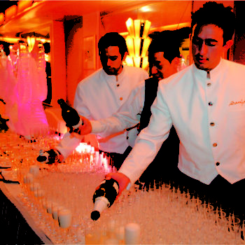 catering staff pouring the champagne